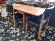Sale 8822 - Lot 1555 - Vintage Extension Draw Leaf Dining Table and Four Chairs