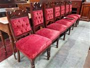 Sale 8939 - Lot 1096 - Set of Seven Edwardian Carved Pine Chairs, including a nursing chair, upholstered in buttoned red velvet (one leg damaged). H: 102,...
