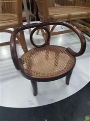 Sale 8634 - Lot 1071 - Small Childs or Dolls Bentwood Armchair, the back with central ring & caned seat