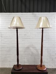 Sale 9080 - Lot 1099 - Pair of timber floor lamps - 1 teak, 1 walnut