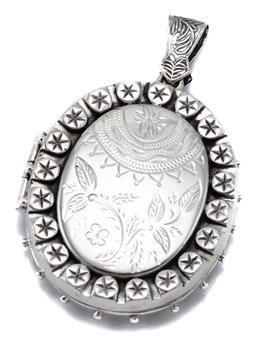 Sale 9149 - Lot 327 - A VICTORIAN STYLE LARGE SILVER LOCKET PENDANT; oval locket engraved front and back opening to twin compartment, size 60 x 40mm, wt....