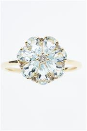 Sale 8299J - Lot 343 - AN 18CT GOLD GEMSET FLORAL CLUSTER RING; set with 7 pear cut aquamarines and 8 round brilliant cut diamond totalling 0.13ct, size N-O.