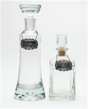 Sale 8575J - Lot 81 - Two non-matching glass decanters, one marked Italy, the other Poland, taller height 32cm, together with Sterling Silver matching...