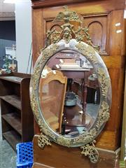 Sale 8570 - Lot 1064 - Pressed Metal and Brass Oval Mirror