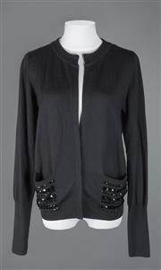 Sale 8493A - Lot 26 - An Oroton black merino wool cardigan with beaded pockets, size large