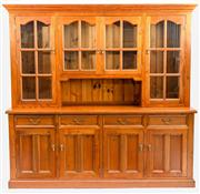 Sale 8599A - Lot 50 - A large vintage pine dresser, the upper section fitted with four glazed doors and interior shelving, the lower four drawers above a...