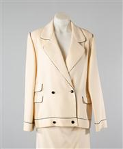 Sale 8740F - Lot 75 - A Tiziani, Roma Chanel style suit in double breasted cream with navy piping, to include jacket and skirt both approx size 10-12
