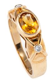 Sale 8899 - Lot 329 - A CITRINE AND DIAMOND RING; rub set in 9ct gold with an oval cut citrine and two round brilliant cut shoulder diamonds, size M, wt....