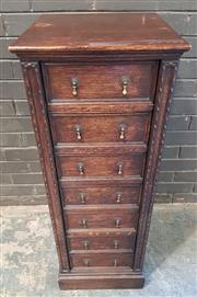 Sale 8976 - Lot 1016 - Early 20th Century Oak Wellington Chest of Seven Drawers, on plinth base (H:107 x W:39 x D:43cm)