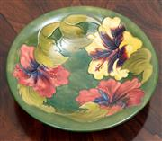 Sale 9070H - Lot 78 - A Moorcroft Hibiscus bowl on a green ground stamped and signed to base, diameter 25cm