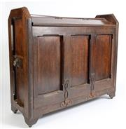 Sale 8599A - Lot 38 - An antique English oak and wrought iron tack box with panelled ends fitted with bronze lion masks, each side with lift-up tops above...