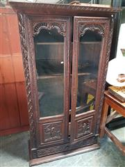 Sale 8868 - Lot 1165 - Late 19th Century Brittany Carved Oak Bookcase, with two glass panel doors, having gallery spandrels & panels of bourgeois couple below