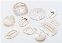 Sale 9190E - Lot 20 - Quantity of mother of pearl belt buckles and buttons, largest Width 6.5cm