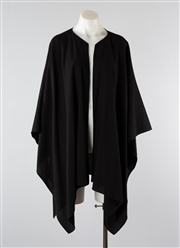 Sale 8740F - Lot 25 - A Carla Zampatti open poncho with handkerchief hem, one size fits most