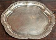 Sale 8976H - Lot 9 - An early C20th 800 silver six lobed tray with engraved well, maker CD, diameter 30cm wt 498