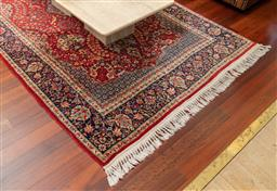Sale 9256H - Lot 8 - A Persian wool carpet with garden of paradise design on red ground with navy border, 250cm x 141cm.