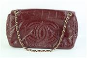Sale 8782A - Lot 165 - A Chanel burgundy flap bag with quilted logo to front, h x 18cm, W x 30cm with packaging authenticity card and box