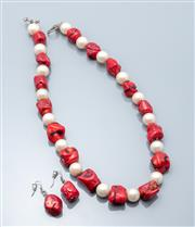 Sale 9037F - Lot 37 - A LARGE CORAL BEAD NECKLACE AND EARRINGS SET; 14-19mm red coral piece and 14mm round faux pearl necklace to toggle clasp, length 55c...