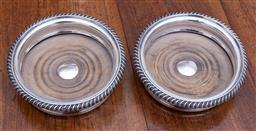 Sale 9190H - Lot 95 - A quality pair of antique silverplate magnum bottle coasters, C: 1900, the timber bases with concentric ring turnings framing vacant...