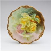 Sale 8660A - Lot 28 - An antique English Royal Doulton cabinet plate painted with yellow and pink roses to a variegated leafy background to a  moulded gil...