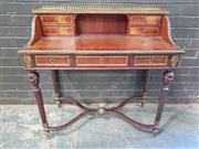 Sale 8976 - Lot 1020 - Louis XVI Style Marquetry Ladys Desk, with brass gallery top, four drawers flanking an alcove, with three frieze drawers below, rai...