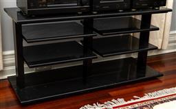 Sale 9256H - Lot 46 - A black marble entertainment unit with shelves, H 61cm x W 123cm x D 46cm.