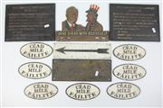 Sale 8417 - Lot 60 - Cod Bottle with Various Cast Metal Signage