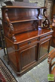 Sale 8335 - Lot 1053 - 19th Century Possibly French Mahogany Chiffonier, with shelves on bold carved brackets, with two drawers and two panel doors (Key in...