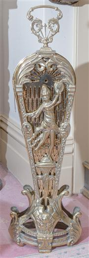 Sale 8430 - Lot 50 - A brass folding fan shaped fire screen, the stand modelled with tambourine girls
