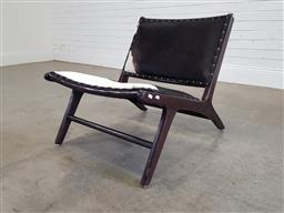 Sale 9191 - Lot 1083 - Cow hide upholstered lounge chair (h60 x w80 x d66cm)