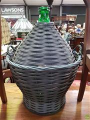 Sale 8589 - Lot 1061 - Large Green Glass Bottle in Basket