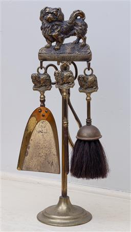Sale 9190H - Lot 45 - A set of Edwardian brass Pekingese fire tools C: 1910, the brush, pan, tongs and poker fitted on the matching stand. Height 47cm