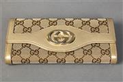 Sale 8493A - Lot 48 - A Gucci bronze canvas and leather purse covered in classic Gucci motif, 19cm wide