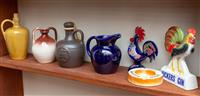 Sale 8735 - Lot 41 - A group of ceramics including French, English and Japanese flasks and jugs, A West German cockerel, A Vickers Gin advertising sign a...