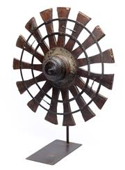 Sale 9070H - Lot 55 - An antique Indonesian spinning wheel or Charkha mounted on a cast iron frame, height 70cm, width 50cm