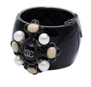 Sale 9083F - Lot 25 - A CHANEL ENAMEL CUFF FROM THE MALTESE COLLECTION; 47mm wide cuff in balck glitter resin applied with cluster of freshwater cultured...