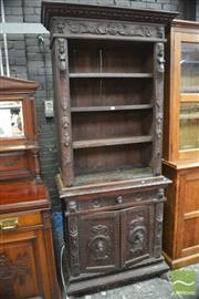 Sale 8317 - Lot 1033 - Small Flemish Renaissance Style Carved Walnut Bookshelf, with caryatids, above a drawer & two panel doors with heads for handles