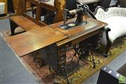 Sale 8361 - Lot 1029 - Antique Cast Iron and Oak Singer Sewing Machine with Drawers