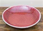 Sale 8489A - Lot 21 - A Col Levy crackle glaze ox blood shallow bowl, David Jones catalogue 323, D 32cm
