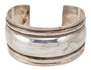 Sale 9083 - Lot 318 - A SILVER CUFF BANGLE; 34.7mmwide with 2 rows of wire twist detail, internal width 60mm, wt. 49.6g.
