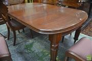 Sale 8335 - Lot 1050 - Victorian Mahogany Extension Dining Table, with D shaped ends, two replacement leaves, on turned and reeded legs (Winder in Office)