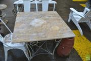 Sale 8383 - Lot 1374 - Travertine Top Outdoor Table on Metal Base
