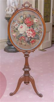 Sale 8430 - Lot 46 - A good Victorian carved walnut pole screen the oval tapestry with Berlin wool work floral panel, on a turned carved pedestal. Height...