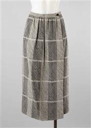 Sale 8740F - Lot 55 - A Giorgio Armani abstract plaid wrap skirt, IT42