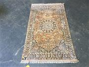 Sale 9048 - Lot 1040A - Kashmir Silk Carpet, with black medallion on salmon field (154 x 95cm)