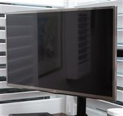 Sale 9023H - Lot 83 - A 32 inch  LG television and stand Model 32LB6500/TH with remote.