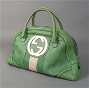 Sale 8493A - Lot 56 - A Gucci green leather shoulder bag, with green and white denim stripe in centre and Gucci motif and brown lining, slight wear, 40cm...