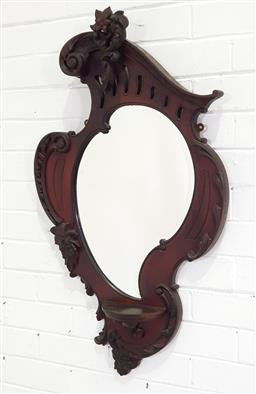 Sale 9196 - Lot 1036 - Edwardian Mahogany Rococo Shield Shaped Wall Mirror, with pierced floral crest, tear shaped mirror & small shelf (h:98 x d54cm)