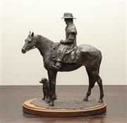 Sale 8871H - Lot 178 - A bronze effect stockman riding a horse with his faithful dog, Height 34cm