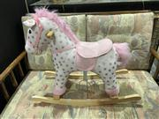 Sale 8876 - Lot 1058 - Modern Girls Rocking Horse (Buttons Work)